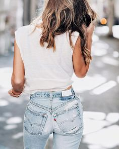 Classic white teeshirt and faded, high waisted jeans. The perfect combo. Great casual outfit for anytime.