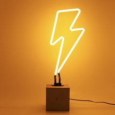 Bring some brightness to your home or work space with our beautiful neon signs. Lightning neon sign is available in yellow. Glass Neon with a concrete base and adaptor plug (included). Once the light is put together dimensions are: x inch Orange Aesthetic, Aesthetic Colors, Organizar Instagram, Neon Box, Jaune Orange, Wally West, Wall Mounted Lamps, Lightning Bolt, Neon Lighting