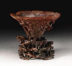 A RHINOCEROS HORN 'SQUIRREL AND GRAPEVINE' LIBATION CUP QING DYNASTY, 17TH / 18TH CENTURY - Sotheby's