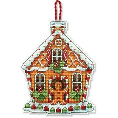 """From designer Susan Winget, this Gingerbread House Ornament counted cross stitch kit from Dimensions lets you create a whimsical ornament for the Christmas tree or to give as a gift. You will love displaying this holiday favorite year after year! Finished size 3.25"""" x 4.25"""". © Susan Winget.Counted cross stitch kit contains: • presorted cotton thread• 14 count plastic canvas• Needle• Easy instructions"""