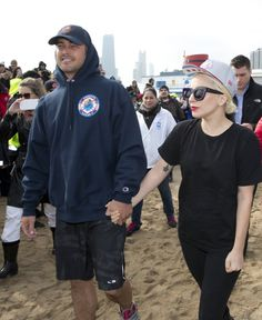 Pin for Later: Lady Gaga and a Shirtless Taylor Kinney Jump Into Frigid Lake Michigan Waters For Charity