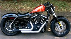My 2011 HD Sportster Forty-Eight - Orange candy tank with 2' uplift kit - V&H short stock chrome exhaust - Screaming eagle sparks - RSD black ops turbine air breather - RSD nostalgia rocker box cover contrast cut - Lepera pleated backbones solo seat - Genuine HD Get-a-Grip - La Rosa faux black left saddle bag- Blackened derby cover- Dynojet Power Commander V