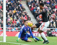 Martial (far left) delicately lifts the ball over the head of Vito Mannone from a tight angle after the Sunderland goalkeeper had saved