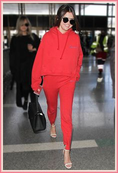 Going for the matching trackies, Selena Gomez elevates her look in barely there heels, oversized sunnies and a sleek pony