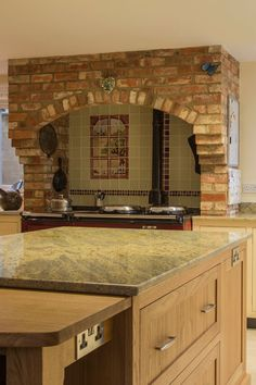Which catches your eye first, the aga surround or the granite worktop? www.benchwoodkitchens.co.uk