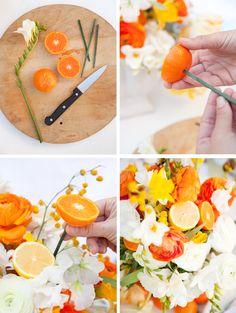 Using lovely orange halves in a bouquet . . .