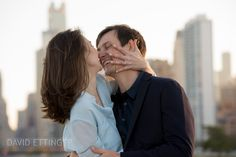 This was a great moment.  We were joking about how to show off the ring for the engagement pictures.  Chicago skyline in the background.  Photo by David Ettinger.  http://davidettinger.com