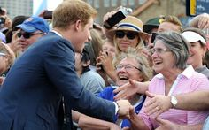 Britain's Prince Harry (L) meets members of the public during a walk around at Campbell's Cove. Picture: AFP/GETTY