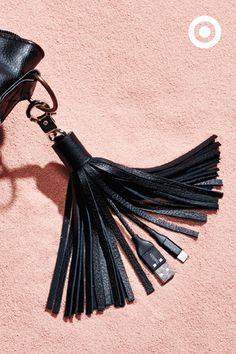 An accessory that's not only trendy, but tech-smart?? Sign us up! The Belkin Lightning to USB Leather Tassle will keep you connected and looking fresh wherever your go.