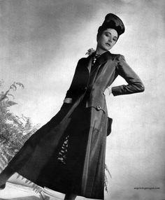 1937. Vogue UK. Coat by Schiaparelli.  Photo by Horst P. Horst (B1906-D1999)