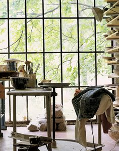 A Potter's Passion - Light-Filled Studio Floor-to-ceiling windows welcome light and wooded views.