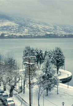 The lake of Kastoria in snow... Kastoria, Greece (by nick_tg on Flickr)