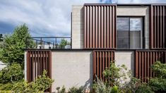 Box-framed louvres shade board-marked concrete house in Tel Aviv