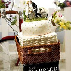 """テーマは""""サイクリング""""! #自転車 に乗って運ばれてきたのは、ケーキも#ケーキトッパー も自転車モチーフ 自転車愛の詰まったウェディングケーキに、ゲストもあっと驚くはず。  こちらのケーキトッパーは#ChicLADYwedding で販売予定です。 #結婚式準備 #結婚式DIY #花嫁DIY#プレ花嫁 #結婚式 #ウェディングアイデア #ウェディングコーディネート #ウェディングデコレーション #ウェディングフォト #海外ウェディング #ウェルカムアイテム #ウェディングインスピレーション #weddinginspiration #自転車ノアル風景 #wedding #ガーデンウェディング  #テーマウェディング #2016夏婚 #ウェディングケーキ #caketopper #ケーキトッパーchiclady #新郎新婦ケーキトッパー #ケーキトッパー #bike  #bicycle #チャリ  #サイクリング"""