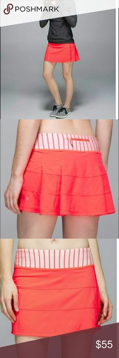 Lululemon Pace Rival skirt Orange skort with stripe shorts underneath.  In good preloved condition. Worn a few times. Size 6. lululemon athletica Skirts