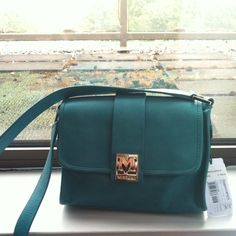 Last chance!! Missoni purse Teal missoni bag bought from Missoni store in London.. Paid 398 pounds.. $620 US dollars.. Can be worn cross body too.. Silver M emblem on front of purse.. Color is fun and bag is perfect size for those In between days u don't feel like carrying a big purse..No trades.. Missoni Bags