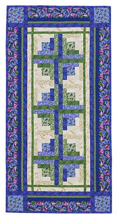 Stitch a 12-block table runner using Log Cabin blocks in two colorways. By using a color scheme of purple, green, and cream, designer Debbie Beaves stitched a season-spanning table runner that shows off her Dolce collection for RJR Fabrics [1]. [1] http://www.rjrfabrics.com