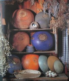 Love all the bowls......Primitive Wood Cupboard...filled with painted but worn old wooden bowls...drieds.