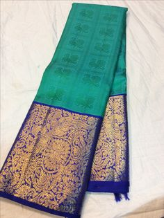 Color : dark green and purpleSaree Fabric : Pure SilkBlouse Fabric : Pure SilkSaree Size : MtrBlouse Size : Mtr Indian Bridal Sarees, Wedding Silk Saree, Indian Silk Sarees, Pure Silk Sarees, Kerala Saree, Ethnic Sarees, Wedding Saree Blouse Designs, Silk Saree Blouse Designs, Saree Blouse Patterns