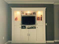 Built in entertainment center with storage cabinets