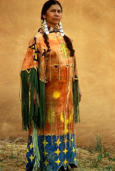 A Kiowa woman wears a Ghost Dance Dress