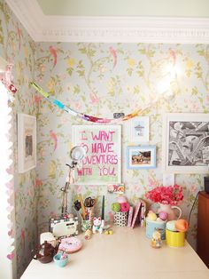 Cute crafting station.  Love the print on the wall!