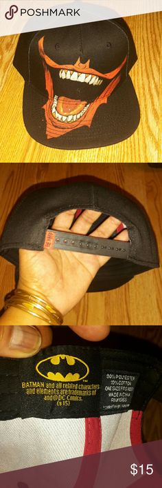 Weird & Unique Ball Cap_NWOT Brand new. Never worn. It's black with red, white and black for the weird picture.. It's also adjustable. Batman  Accessories Hats