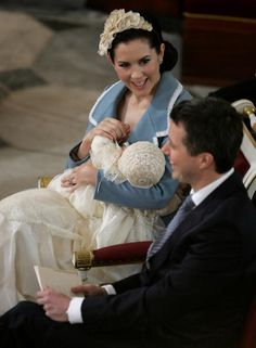 January 21, 2006--Crown Princess Mary of Denmark smiles as she cradles her son and heir to the Danish throne Crown Prince Christian of Denmark as her husband Crown...