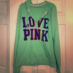 Love Pink sweatshirt Lime green Victoria's Secret Love Pink hooded sweatshirt. V neck front with LOVE PINK in black with a colorful outline. Pink is also written down one sleeve. Super comfortable!! Victoria's Secret Tops Sweatshirts & Hoodies