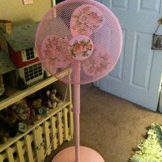 This was a plain white plastic floor fan that was pretty boring and just plain ugly! I took it apart spray painted it pink. And put some fabric flowers on the blades with mod podge it came out pretty well! Completely shabby chic which was my goal! And not boring to look at anymore!..... Hmmm. Ceiling fan???