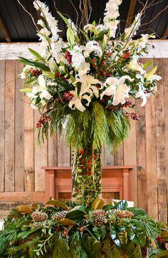 Wedding reception barn, wedding décor, Christmas wedding, wedding reception, floral centerpiece, Christmas wedding flowers. Rustic barn wedding and reception venue in Alabama whiteacresfarms.com