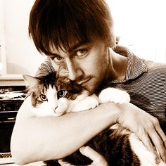 Torrance Coombs OMG @Claire Frith HE'S HOLDING A CAT. A CAT. WITH THE SAME EYES AS HIM. OMG FAINT.