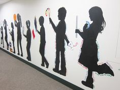 Our Silhouette Mural is Finished! Our silhouette mural is finished! It went pretty quickly once we got started. Each of the figures represents different subject areas at school. School Entrance, School Hallways, School Murals, Art School, Hallway Art, School Painting, School Displays, Collaborative Art, School Decorations