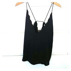 Urban Outfitters top Black super soft urban outfitters top. The top has a scallop cut and a sexy back. The brand is kimchi blue and it was worn only once. Its gorgeous but too big on me :/ Urban Outfitters Tops
