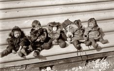 Five small Eskimo children sit bundled in fur garments. Photographed by Frank H. Nowell, the official photographer for the Alaska-Yukon-Pacific Exposition, c. 1908.