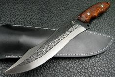 Handmade Chrysanthemum Custom Bowie Knife. My favorite type of knife! Beautiful etching on the blade.