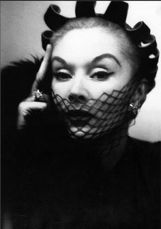Lisa Fonssagrives is wearing a hat called 'Petal Coif' by John Frederics. New York, 1950.