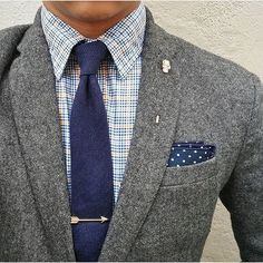 Tie bar with a suit