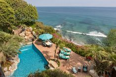 There is an open patio with a heated pool looking down on the shore. The property also has direct access to the Malibu beach