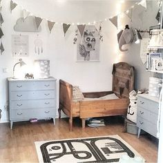 Comfortable and cute kids room with carved wooden bed