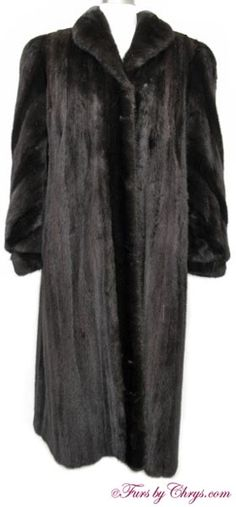 Ranch Mink Coat #RM729; $1500.00; Excellent Condition; Misses 8 - 12. This is a gorgeous genuine natural ranch mink fur coat. This coat may be constructed with Blackglama® fur pelts, as there was a slip with instructions for the furrier, written by Blackglama®, inside the inner pocket.  It features a shawl collar and sleeves with pelts sewn on the diagonal ending in banded bracelet cuffs. When you wear this ranch mink coat you will feel so elegant and luxurious!