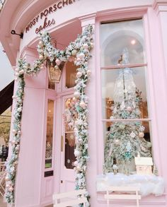 [Lovely pink Christmas decor on this shop that normally has beautiful flowers on it. I like this look. It would also be pretty with aqua or light blue ornaments added to the pink. Or pink and red--how cool would that be! For Easter, they could use pink, lavender, and yellow.]