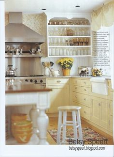 betsy speert from long ago in vermont, the yellow cabinets are gorgeous