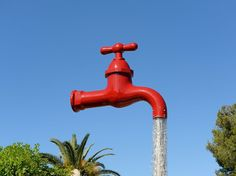 "The fantastical tap fountain near Santa Galdana beach in Menorca is just one of many ""floating faucets"" around the world. Different versions of this optical-illusion-in-real-life can be found in Belgium, Canada, and other parts of Spain."