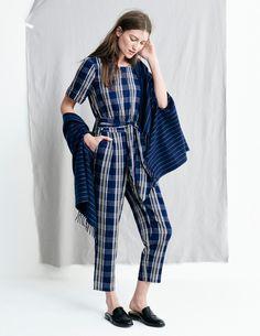 madewell fall 2015 #fallmadewell. blue plaid short-sleeved jumpsuit, black loafer slides.