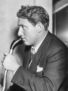 Spencer Tracy uses a Dictaphone dictation machine in a publicity still for The Murder Man (1935)