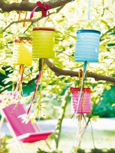 Paper lanterns hanging in tree (1) From: Stijlvol Styling, please visit