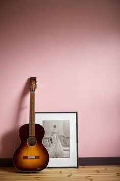 A portrait of my grandma and my husbands guitar...Colour on the wall is Farrow & Balls Nancy's Blushes. Photo by Klas Sjöberg.