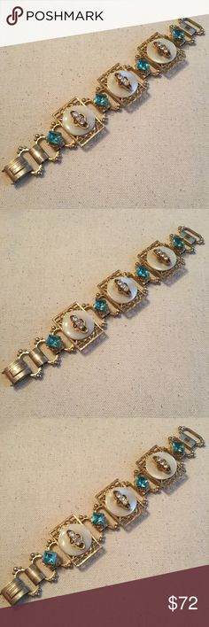 Vintage 1950s Abalone Shell Style Crystal Bracelet Vintage 1950s Abalone Shell Style Crystal Rhinestone Bracelet. Blue faceted square rhinestones. Abalone shell style. Gorgeous backing. Fabulous detail and design. Fold over clasp with great detailing. 7 inches. Overall amazing bracelet! Vintage Jewelry Bracelets