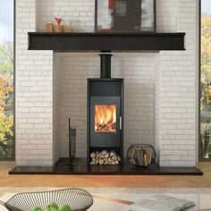 Like the look of the black mantle against white. And the long lean look of the stove. Modern Wood Burning Stoves, Pellet Stove, Hearth And Home, Wood Burner, Living Room Decor, Woodburning, New Homes, Phoenix, Contemporary